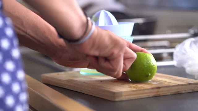 detail of hands cutting a lime - lime stock videos and b-roll footage