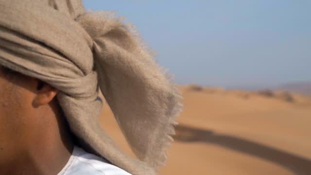 Detail of head scarf in desert
