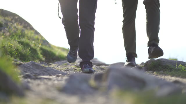 detail of hiker footsteps at sunset - mont blanc stock videos & royalty-free footage