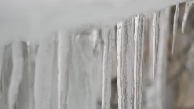 detail of icicles on roof eve - 40 seconds or greater stock videos & royalty-free footage