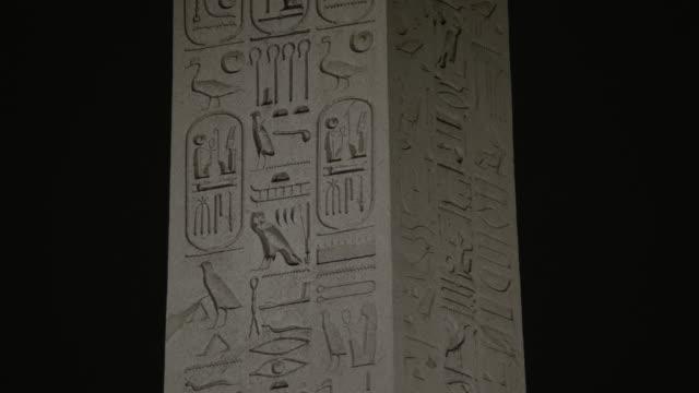 cu detail of luxor obelisk at place de la concorde / paris, france - hieroglyph stock videos & royalty-free footage