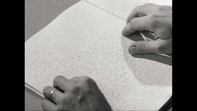cu detail of man reading book / united states - braille stock videos & royalty-free footage