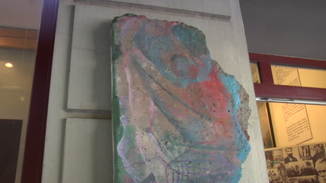 detail of piece of concrete from the berlin wall featuring colorful artwork. - concrete wall stock videos & royalty-free footage