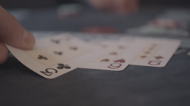 detail of player's hands gambling in casino playing black jack - gambling stock videos & royalty-free footage