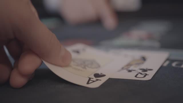 detail of player's hands gambling in casino playing black jack - blackjack video stock e b–roll