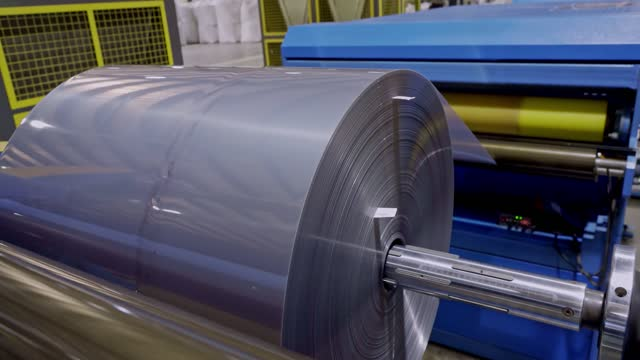 detail of production line of rolled up laminate plastic manufacturing - heavy metal stock videos & royalty-free footage
