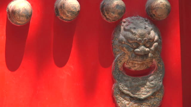 cu detail of red door with antique knocker, forbidden city / beijing, china - door knocker stock videos & royalty-free footage