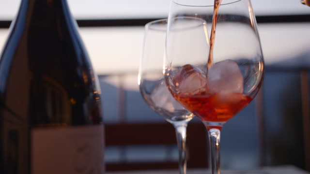 detail of spritz drink cocktail being prepared on ice - wine bottle stock videos & royalty-free footage