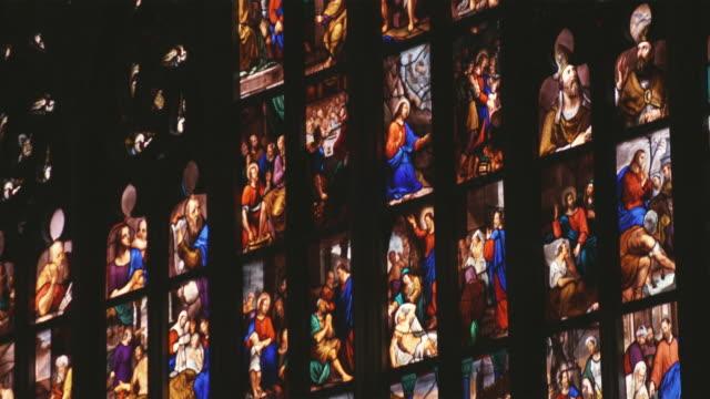 vídeos de stock, filmes e b-roll de cu tu detail of stained glass window / milan, italy - armação de janela