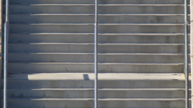 detail of stairs and bleachers benches seats seating at a football stadium. - slow motion - bench stock videos & royalty-free footage