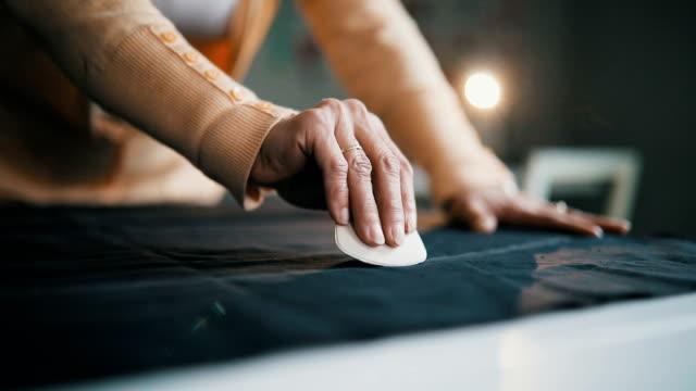detail of tailor's hand with chalk - design studio stock videos & royalty-free footage