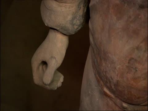 cu detail of terracotta warrior hand, museum of qin, xian, china - terrakotta armee stock-videos und b-roll-filmmaterial