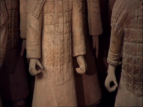 cu detail of terracotta warrior hands and armour, museum of qin, xian, china - terrakotta armee stock-videos und b-roll-filmmaterial