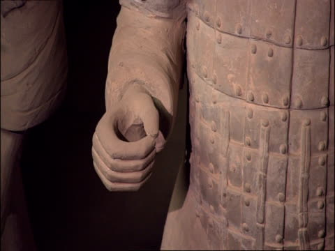 cu detail of terracotta warriors hand and armour, museum of qin, xian, china - terrakotta armee stock-videos und b-roll-filmmaterial