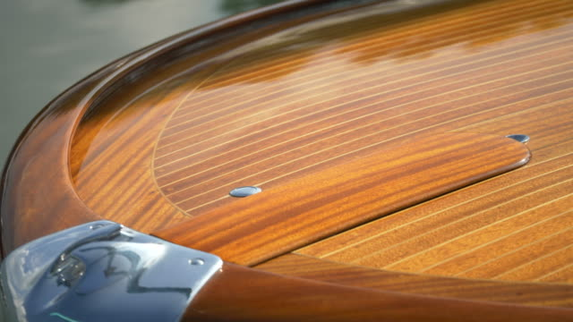 Detail of the bow of a classic luxury wooden runabout boat. - Slow Motion