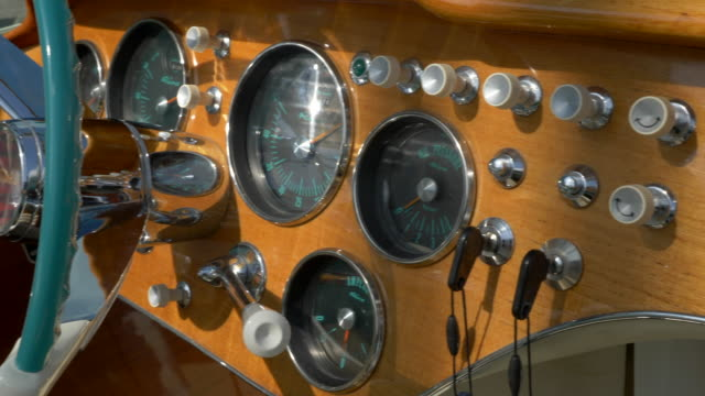 detail of the dashboard on a classic luxury wooden runabout boat. - slow motion - dashboard stock videos & royalty-free footage