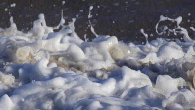 detail of the whitewash as waves break in the surf. - attitude stock videos & royalty-free footage