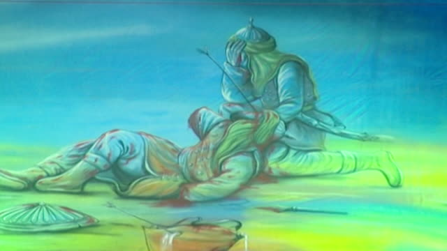detail of traditional imagery shown during the ashura commemorations. the painting depicts the tragedy of the battle of karbala and the tragic death... - ashura muharram stock videos & royalty-free footage