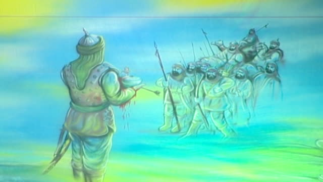 detail of traditional imagery shown during the ashura commemorations. the painting depicts the death of hussain ibn ali's six month old son at the... - ashura muharram stock videos & royalty-free footage