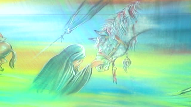 detail of traditional imagery shown during the ashura commemorations. the painting depicts zaynab bint ali, hussain's half sister and a heroin the... - ashura muharram stock videos & royalty-free footage