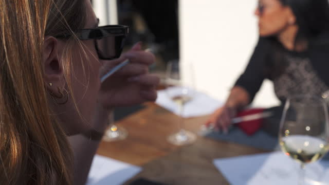 vídeos y material grabado en eventos de stock de detail of woman eating food at dining table - female friendship