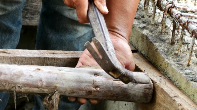 detail of worker with a nail and a hammer - timber stock videos & royalty-free footage