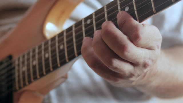 detail of young musicianplaying electric guitar at studio - fretboard stock videos & royalty-free footage