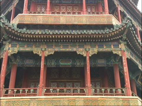 ms detail on summer palace, zooms out to low, wide angle view of palace, beijing, china - summer palace beijing stock videos & royalty-free footage