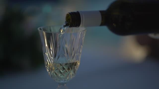 detail serving white wine