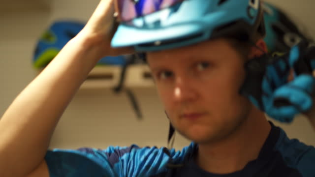 detail shot of a cyclist putting on a helmet - cycling helmet stock videos & royalty-free footage