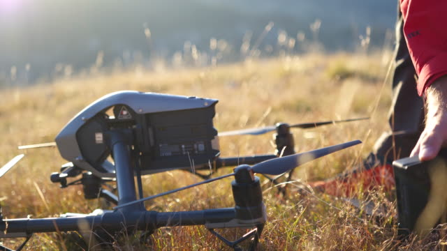 detail shot of a drone operator setting up a drone - durmitor national park stock videos & royalty-free footage