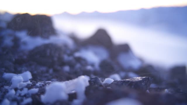 detail shot of a hikers boot on snowy rocks - boot stock videos & royalty-free footage