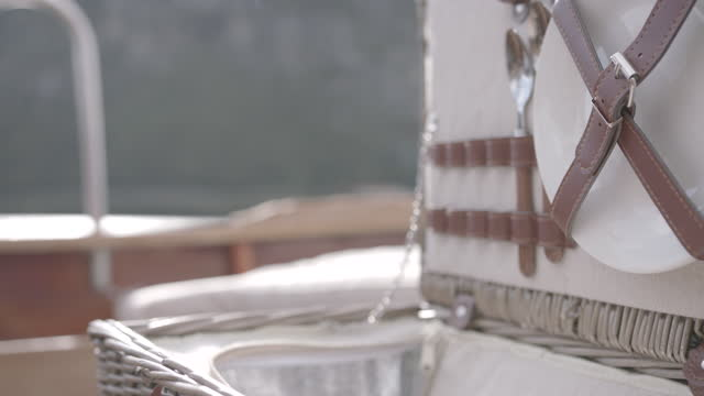 detail shot of a picnic basket opening on a boat with dinnerware - hamper stock videos & royalty-free footage