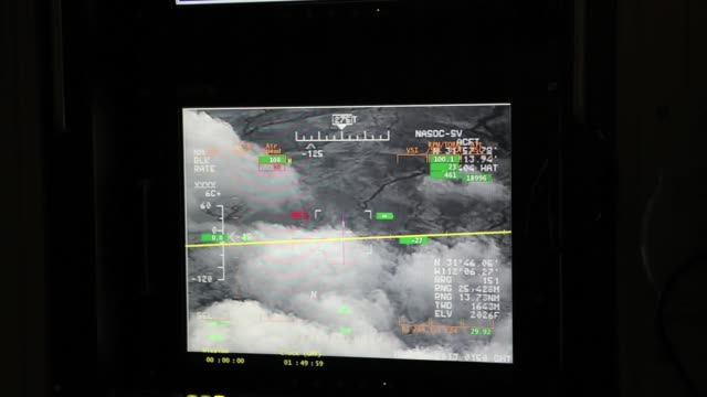 stockvideo's en b-roll-footage met detail shot of a screen in the flight operations center where pilots control the predator from the ground. u.s. air and marine predator drones launch... - control