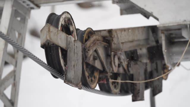 detail shot of a ski lift wheel system - seggiovia video stock e b–roll
