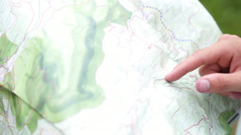 detail shot of hikers looking at a map - exploration stock-videos und b-roll-filmmaterial
