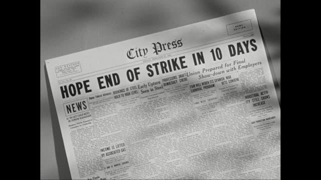 vídeos de stock, filmes e b-roll de cu zi ha detail shot of newspaper headline / united states - greve