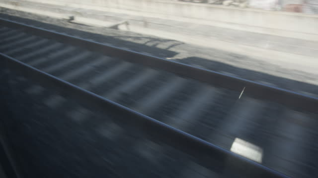 detail shot of train tracks passing by window view - ferrovia video stock e b–roll