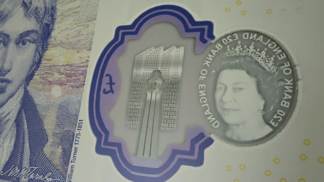 a detail view of some of the artwork detailing on a large scale sample of the new twenty pound note during the launch event at the turner... - british pound sterling note stock videos & royalty-free footage