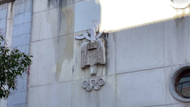 detail view of the pre-constitutional bas-relief shield on the front of the moscardo municipal sports center on february 10 in madrid, spain. the... - basrelief stock-videos und b-roll-filmmaterial