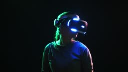 Detail woman wearing VR headset and turning head around