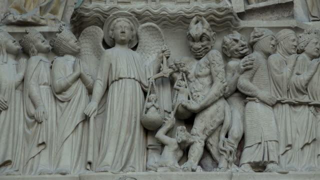 details cat entrance portal of notre dame cathedral, paris, ile de france, france - notre dame de paris stock videos and b-roll footage