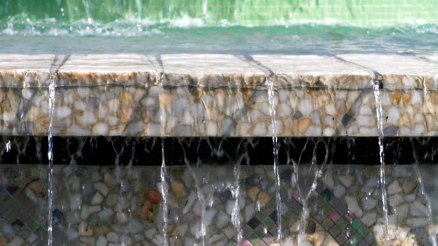 details of a city fountain. close-up shot of flowing water. urban scene. public park. city life - splashdown stock videos & royalty-free footage