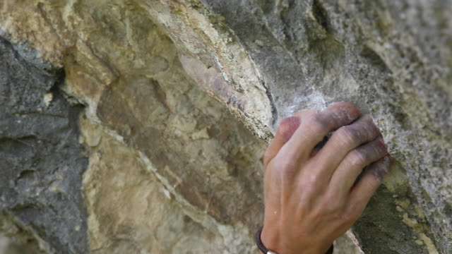 details of a man rock climbing up a mountain and his hand holding on. - desire stock videos & royalty-free footage