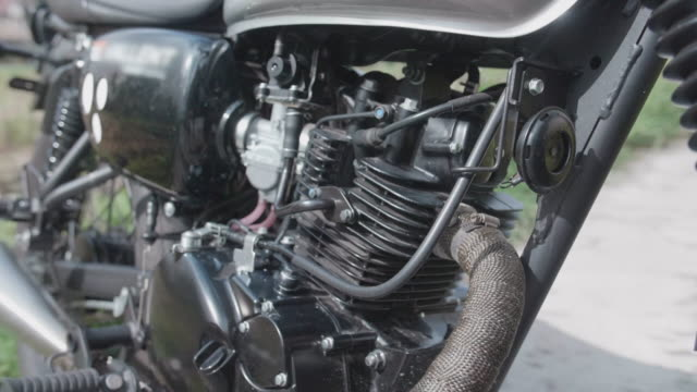 details of a motorcycle and engine. - motorcycle biker stock videos & royalty-free footage