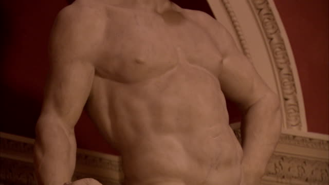 details of a statue reveal a man's naked torso. available in hd. - torso stock videos & royalty-free footage