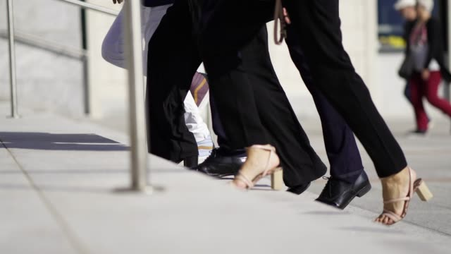details of business people's feet walking up steps - low section stock videos & royalty-free footage