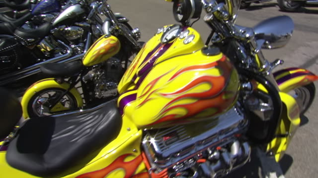 ms zi tu details of huge yellow boss hoss motorcycle painted with flames parked on main street during sturgis motorcycle rally / sturgis, south dakota, united states - south dakota stock-videos und b-roll-filmmaterial