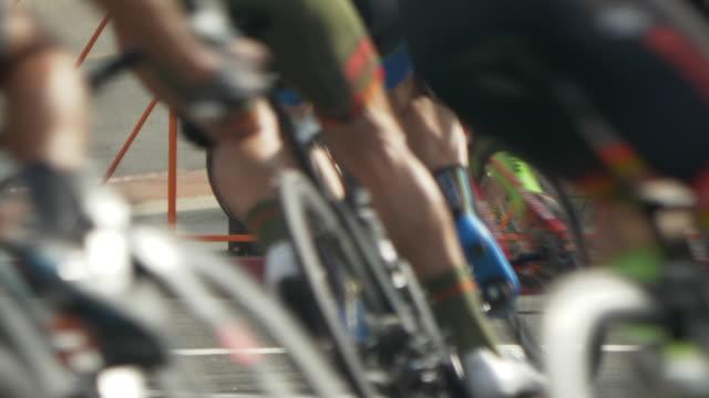 Details of men racing in a road bike bicycle race.