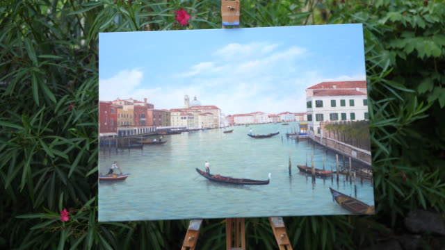 details of oil painting of venice, italy on an easel in a garden. - slow motion - easel stock videos and b-roll footage